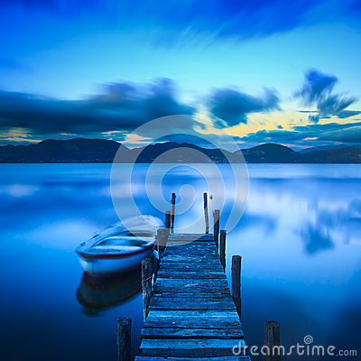 Free Wooden Pier Or Jetty And A Boat On A Lake Sunset. Versilia Tusca Royalty Free Stock Photo - 46069515