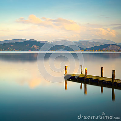 Free Wooden Pier Or Jetty And On A Blue Lake Sunset And Sky Reflectio Royalty Free Stock Image - 46215646