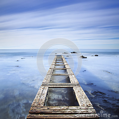 Free Wooden Pier Or Jetty On A Blue Ocean In The Morning.Long Exposur Stock Image - 49524521
