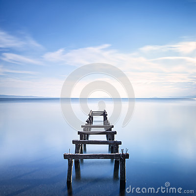 Free Wooden Pier Or Jetty Remains On A Blue Lake. Long Exposure. Stock Photography - 35310772