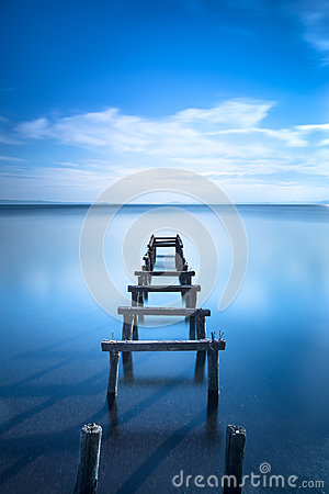 Free Wooden Pier Or Jetty Remains On A Blue Lake. Long Exposure. Royalty Free Stock Photo - 38543825