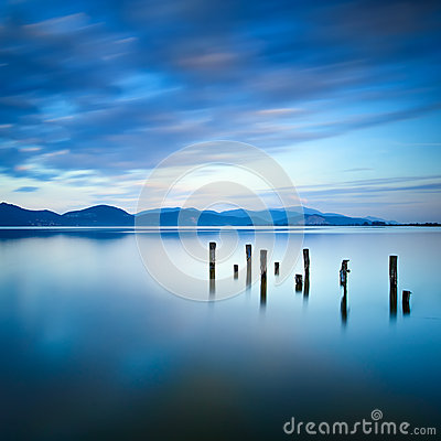 Free Wooden Pier Or Jetty Remains On A Blue Lake Sunset And Sky Reflection On Water. Versilia Tuscany, Italy Royalty Free Stock Photography - 34791377