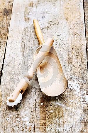 Wooden pizza cutter and flour shovel