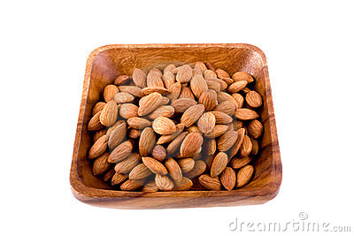 Wooden plate with almonds