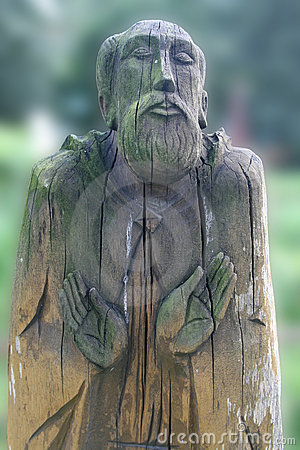Wooden praying old man