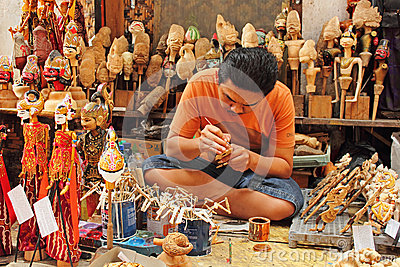Wooden puppet maker Editorial Stock Photo