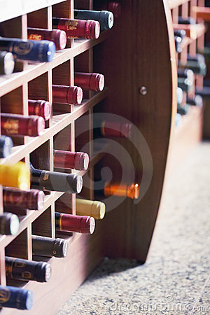 Wooden rack with wine bottles
