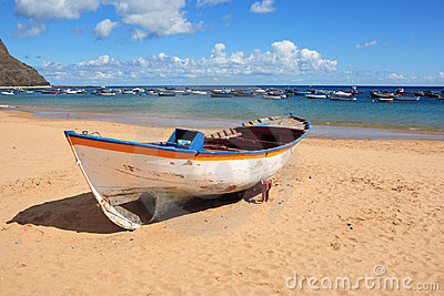 Wooden rowboat on beach