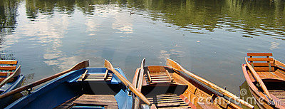 Wooden rowing boats on lake