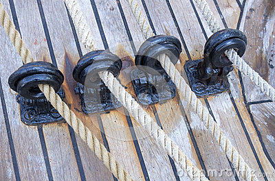 Wooden sailboat pulleys and ropes
