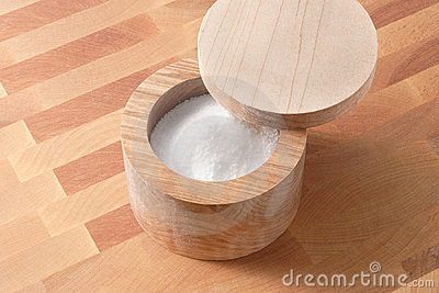 Wooden salt box on wood cutting board