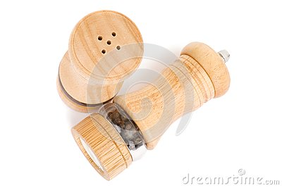 Wooden saltcellar and mill for pepper over white