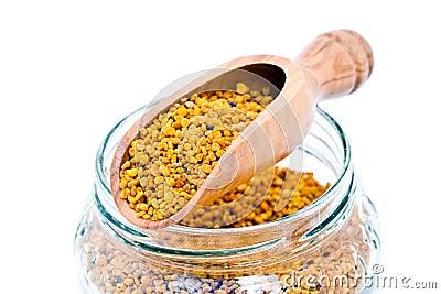 Wooden scoop and bee pollen