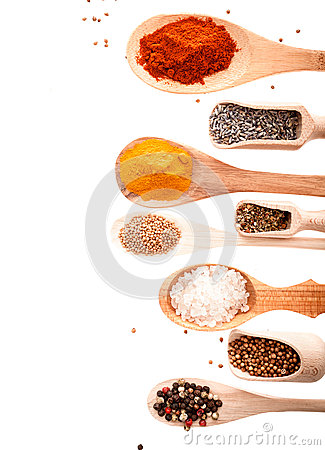 Wooden scoops and spoons with assorted spices