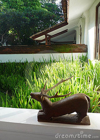 Wooden sculpture on patio