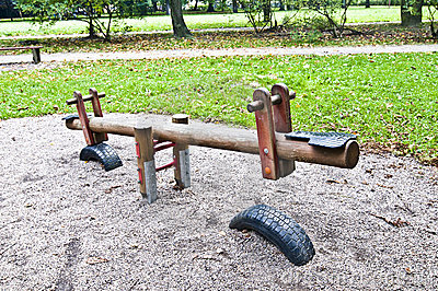 Wooden seesaw in the park, playground