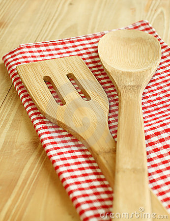 Wooden serving spoons on checkered napkin