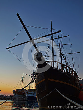 Wooden ship in sunset