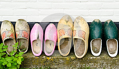 Wooden shoes against a wall