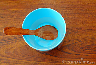 Wooden spoon in blue bowl