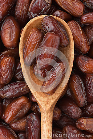 Wooden spoon with dried dates