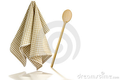 Wooden spoon and kitchen towel
