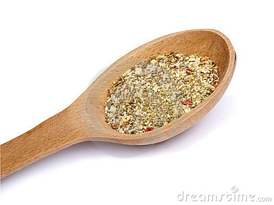 Wooden spoon with mixture of dry spices