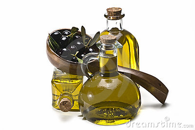 Wooden spoon, olives and oil.