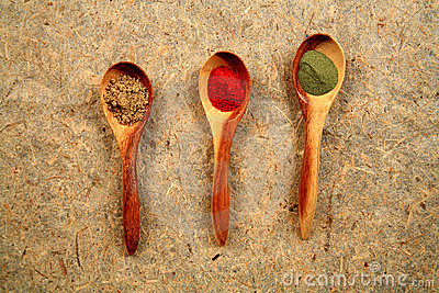 Wooden spoons and dried spices.