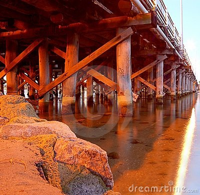 Free Wooden Support Of Pier Bridge Over River And Rock Stock Photography - 1531042