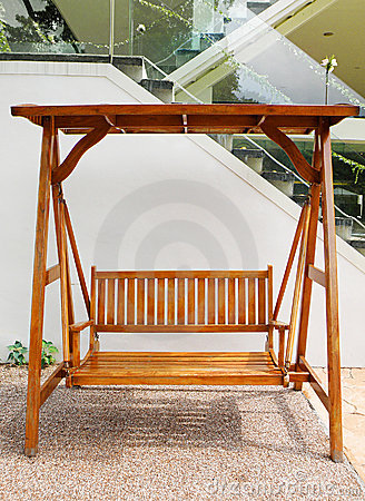 Wooden swing with double seat outdoors