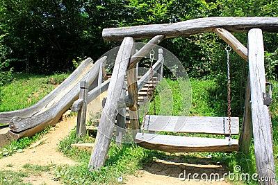 Wooden swing and slide for children