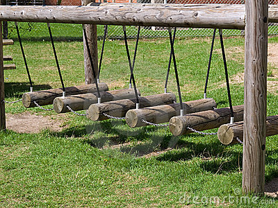 Wooden swings in a playground