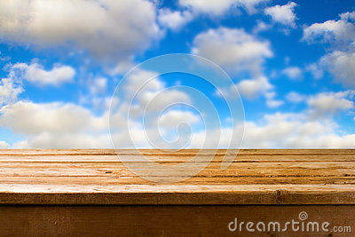 Wooden table against blue sky