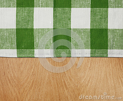 Wooden table with green gingham tablecloth