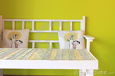 Wooden table with green wall