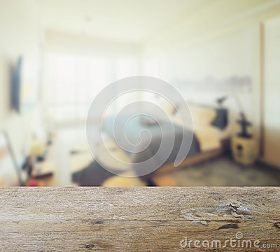 Free Wooden Table Top With Blur Of Modern Bedroom Interior Stock Image - 79403091