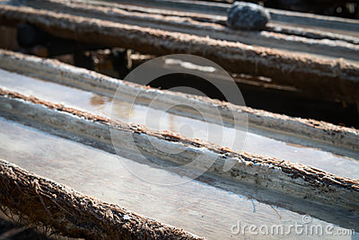 Wooden tanks for sea salt production in Bali, Indonesia
