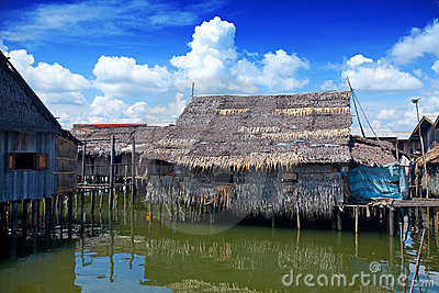 Wooden thatched roof houses on stilts