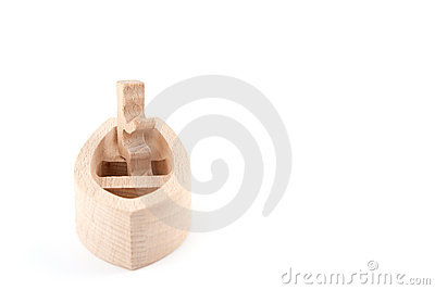 Wooden toy figure in the boat