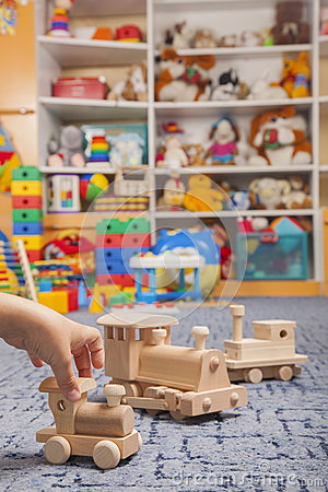 Wooden train in the play room Stock Photo