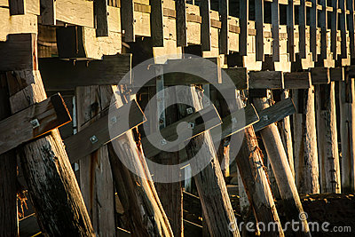 Wooden trestle bridge in sunlight