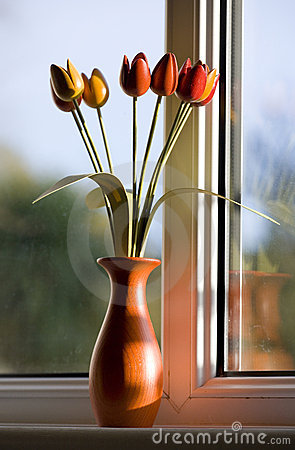 Wooden tulips by window