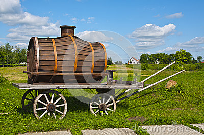 The wooden wagon with a barrel