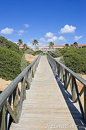 Wooden walkway on sandy beach in Spain