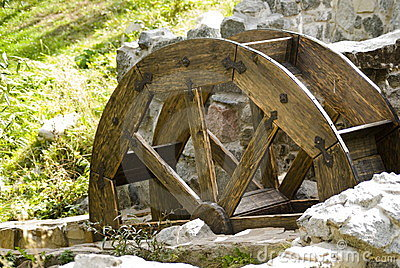 wooden wheel and stone walls