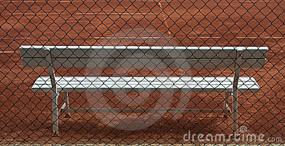 Wooden white seat on tennis court