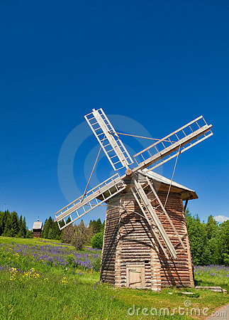 Wooden windmill under clear sky