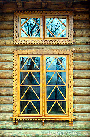 Wooden window on the log wall
