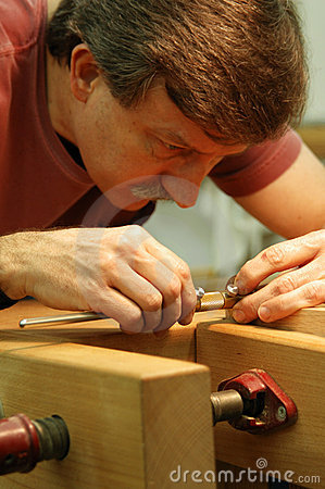 Woodworker Making Close Measurement